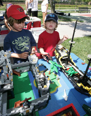 boys playing with LEGO ship at Torrance birthday party