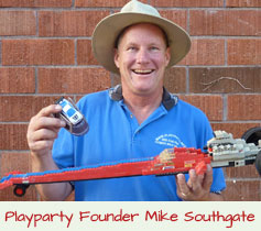 Mike Southgate, founder and owner of Playparty.net with Lego dragstrip racecar